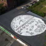 В Новокузнецке появилось граффити в виде гигантского шаманского бубна